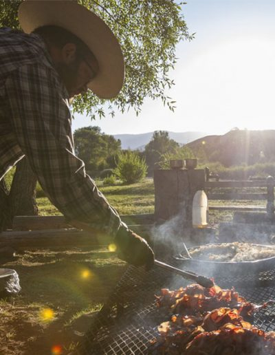 Chef in Cowboy Hat Cooking Bacon on Campfire - Lazy L&B Dude Ranch Wyoming