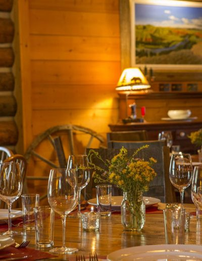 Log Cabin Dining Room with table set for dinner - Lazy L&B Dude Ranch Wyoming