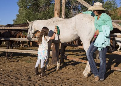 Girl Grooming Horse with Wrangler Lazy L&B Dude Ranch Wyoming