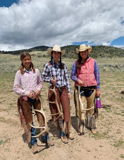 Cowgirls Holding Elk Antler Sheds - Lazy L&B Dude Ranch Wyoming