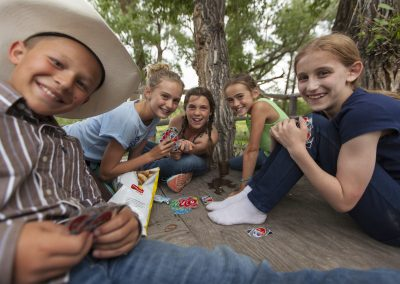 Children Playing Cards in Treehouse - Lazy L&B Dude Ranch Wyoming