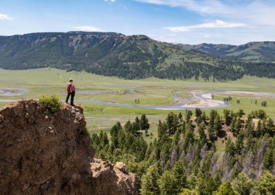 Hiker overlooking Lamar Valley Yellowstone National Park - Lazy L&B Dude Ranch Wyoming