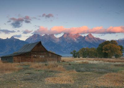 T.A. Moulton Barn at sunrise during fall with the Teton Range - Lazy L&B Ranch Wyoming